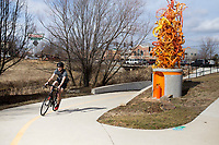 NWA Democrat-Gazette/CHARLIE KAIJO Christian Beasley of Bentonville rides his bike, Thursday, February 15, 2018 at the Razorback Greenway in Bentonville. <br />