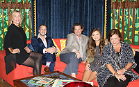 NWA Democrat-Gazette/CARIN SCHOPPMEYER Cynthia McClanahan (from left), Jason Howard, Chris Goddard, Lindsay Crockett and Melissa Cherry, of the Goddard Group, sit in the lounge they created to accompany the Stuart Davis exhibition at Crystal Bridges.