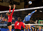 BROOKINGS, SD - SEPTEMBER 25:  Kelly Law #1 from the University of South Dakota tries to block a kill attempt on Ashley Beaner #11 from South Dakota State University during their match Sunday afternoon at Frost Arena. (Photo by Dave Eggen/Inertia)