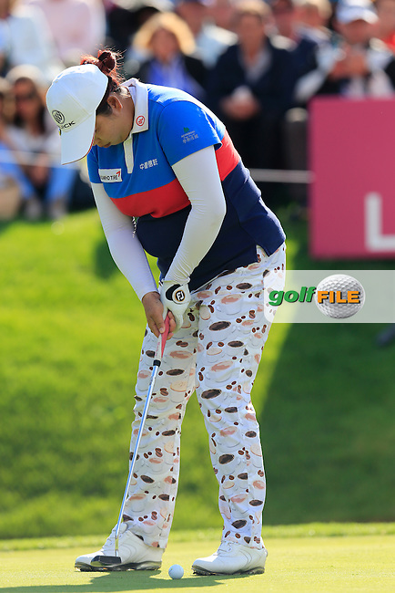 Shanshan Feng (CHN) takes her putt on the 18th green during Sunday's Final Round of the LPGA 2015 Evian Championship, held at the Evian Resort Golf Club, Evian les Bains, France. 13th September 2015.<br /> Picture Eoin Clarke | Golffile