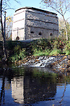 The Menomonee River and Falls in front of the historic Lime Kiln preserved in a park