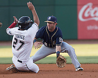 NWA Democrat-Gazette/J.T. WAMPLER The Naturals' Ramon Torres gets caught at second base by Casey McElroy Thursday Aug. 13, 2015 during the Naturals game against the San Antonio Missions at Arvest Ballpark in Springdale.