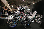"""Jan 15, 2010 - Chiba, Japan - A Suzuki motorbike """"bosozuku style"""" is displayed on Junction Produce booth during the Tokyo Auto Salon 2010 in Chiba, suburb Tokyo, on January 15, 2010. More than 400 companies, associations and groups are displaying more than 600 custom vehicules in the Japan's biggest tuning show which takes place between January 15 and 17. (Photo Laurent Benchana/Nippon News)."""