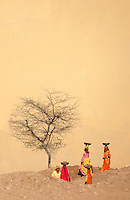 Women working at the base of a giant Sand dunes of Jaisalmer 100 KM from the Pakistan Border in the Thar desert, Rajasthan India