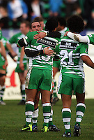 Manawatu's Aaron Cruden hugs Johnny Leota after the win during the Air NZ Cup rugby match between Manawatu Turbos and Counties-Manukau Steelers at FMG Stadium, Palmerston North, New Zealand on Sunday, 2 August 2009. Photo: Dave Lintott / lintottphoto.co.nz
