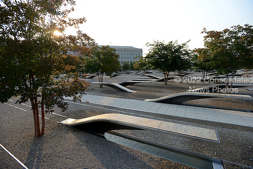 The sun rises over the Pentagon and the Pentagon Memorial on September 11, 2013.  United States President Barack Obama will commemorate the 12th anniversary of the 9/11 terrorist attacks that killed nearly 3,000 people in New York, Washington and Shanksville, Pennsylvania.  There are 184 benches in the Pentagon Memorial representing the 184 people who died at the Pentagon on September 11, 2001.  <br /> Credit: Pat Benic / Pool via CNP