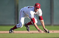 STANFORD, CA - March 29, 2011: Stephen Piscotty of Stanford baseball gets up from fielding a groundball during Stanford's game against St. Mary's at Sunken Diamond. Stanford won 16-14.