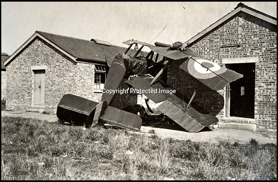 BNPS.co.uk (01202 558833)<br /> Pic: C&TAuctions/BNPS<br /> <br /> Failiure to stop resulted in this impact into the Cranwell huts...<br /> <br /> Those not so magnificent men in their flying machines...<br /> <br /> A newly discovered album of of photographs from the First War illustrates the difficulties and dangers of the earliest days of flight.<br /> <br /> Thought to have been collected by an unknown officer at the RNAS school of flying at Cranwell during the war, the album catalogues the thrills and spills of a time before health and safety.<br /> <br /> Multiple collisions, perilous carrier take off's, impacts with phone lines, random trees and even buildings are all featured - as well as a visit from the King and Queen.<br /> <br /> C&T auctions are selling the unique album on Wednesday 30th March.
