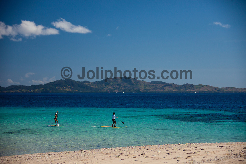 Namotu Island Resort, Fiji. (Tuesday, August 28, 2012) -   Light winds this morning and a very small swell meant people  went spearfishing, wake boarding and SUP'ing to fill in the day. Photo: joliphotos.com