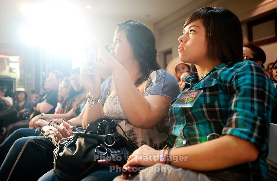 Abi Tijenna (cq, 17, right) and Carolina Morales (cq, 18, left) watch the Macy's Runway Fashion Show at La Plaza Mall in McAllen, Texas, Saturday, April 3, 2010. Stores within the La Plaza Mall have done well throughout the economic crisis due to its proximity to Mexico and the influx of Mexican tourists who purchase goods to bring back home. ...PHOTO/ Matt Nager