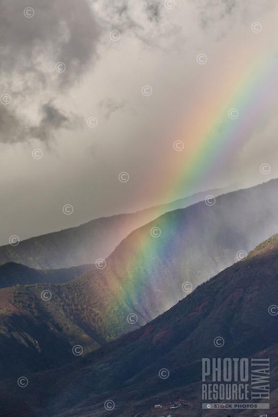 Rainbow over Maui mountains.