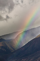 Rainbow over Maui mountains.