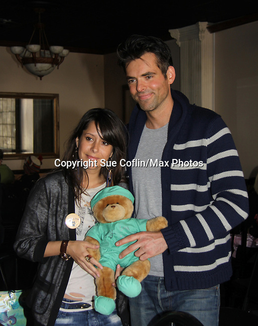 """General Hospital - Kimberly McCullough and Jason Thompson sign a Build-A-Bear """"Patrick"""" at Uncle Vinnie's Comedy Club in Point Pleasant, New Jersey on Novermber 14, 2010 for fun, questions. photos and autographs. (Photo by Sue Coflin/Max Photos)"""