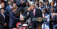 United States President Donald J. Trump congratulates Coach Nick Saban during the welcoming ceremony of the 2017 NCAA Football National Champions: The Alabama Crimson Tide to the White House in Washington, DC, March 10, 2018. <br /> CAP/MPI/RS<br /> &copy;RS/MPI/Capital Pictures