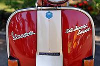 """Classic (antique) red Piaggio Vespa """"150 Super"""" scooter, circa 1960. Da Lat, Vietnam"""