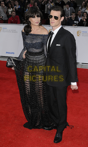 DAISY LOWE & MATT SMITH .Attending the Philips British Academy Television Awards, Grosvenor house Hotel, Park Lane, London, England, UK, May 22nd 2011..arrivals TV Baftas Bafta full length black sheer see thru through dress striped maxi clutch bag off the shoulders bra holding knickers navy couple suit tie sunglasses shades arm around .CAP/CAN.©Can Nguyen/Capital Pictures.