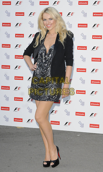 ZOE SALMON.The F1 Party held at the Natural History Museum, London, England, UK..5th July 2010.Formula one full length black jacket blazer hand on hip peep toe shoes platform sequined sequin grey gray silver dress .CAP/CAN.©Can Nguyen/Capital Pictures.