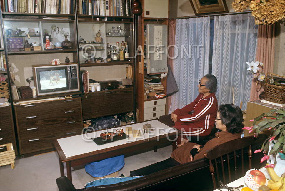 October, 1980. Tokyo, Japan. Japanese families relaxing in their apartment dwellings in Tokyo.