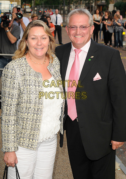 CHERRY & GRAHAM COLE .'An Audience with Donny & Marie Osmond' - Arrivals, ITV Studios, South Bank, London, England, UK, .August 22nd 2009.half length black suit pink tie white trousers grey gray jacket husband wife couple 3/4 .CAP/CAN.©Can Nguyen/Capital Pictures
