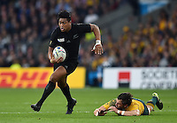 Julian Savea of New Zealand gets past Adam Ashley-Cooper of Australia. Rugby World Cup Final between New Zealand and Australia on October 31, 2015 at Twickenham Stadium in London, England. Photo by: Patrick Khachfe / Onside Images