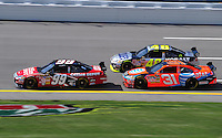 Oct 3, 2008; Talladega, AL, USA; NASCAR Sprint Cup Series driver Carl Edwards (99) leads Jeff Burton (31) and Jimmie Johnson (48) during practice for the Amp Energy 500 at the Talladega Superspeedway. Mandatory Credit: Mark J. Rebilas-