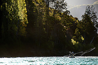 Anglers cast from a drift boat on the Rio Futaleufú in central Patagonia.