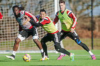 SWANSEA, WALES - FEBRUARY 17:  Marvin Emnes of Swansea City  and Jefferson Montero Play for the ball while Federico Fernandez of Swansea City  looks during a training session at the Fairwood training ground on February 17, 2015 in Swansea, Wales.  (Photo by Athena Pictures )