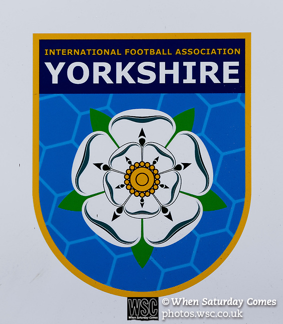The Yorkshire International Football Association logo. Yorkshire v Parishes of Jersey, CONIFA Heritage Cup, Ingfield Stadium, Ossett. Yorkshire's first competitive game. The Yorkshire International Football Association was formed in 2017 and accepted by CONIFA in 2018. Their first competative fixture saw them host Parishes of Jersey in the Heritage Cup at Ingfield stadium in Ossett. Yorkshire won 1-0 with a 93 minute goal in front of 521 people. Photo by Paul Thompson