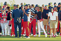 Brooks Koepka (USA) and his girlfriend Jena Sims embrace on the 14th green before the trophy presentation following  round 4 Singles of the 2017 President's Cup, Liberty National Golf Club, Jersey City, New Jersey, USA. 10/1/2017. <br /> Picture: Golffile | Ken Murray<br /> <br /> All photo usage must carry mandatory copyright credit (&copy; Golffile | Ken Murray)