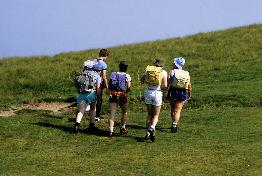 Group walking up a hill side