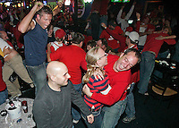 St. Louis Cardinal fans at St. Louis Sports Zone in Shrewsbury celebrate as the Cardinals win the National League Championship Series game 7 against the New York Mets on Thursday, October 19, 2006. The Cardinals won the game 3-1 and the series 4-3.