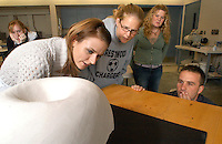 "From left, Concordia University students Sarah Johnson, junior, Alexia Chascsa, senior, Michelle Baumgardner, junior, and Megan Medley, junior, critique a piece of student sculpture during a class taught by Joshua Smith on Thursday, September 28, 2006. In October 2001, Smith was driving a Seward High School bus through a construction zone in west Omaha when it crashed, resulting in the four deaths and injuries to 27 others, including himself. Though Smith has no memories of the accident, a Federal investigation in 2004 placed fault on the Nebraska Department of Roads. ""That was trama. It was and it always will be,"" Smith said. Smith created a half dozen ""embrace vessels"" that symbolize how the Seward community came together and supported him. ""In bending steel, you strengthen it. It's stronger after the fall,"" Smith said. Smith now teaches art at Concordia University in Ann Arbor, Michigan and continues to create sculpture. The piece behind him, named ""Strawberry Roan,"" was completed in july 2006..photo by Danny Gawlowski"