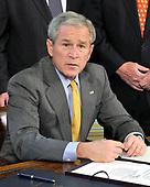 Washington, D.C. - July 29, 2008 -- United States President George W. Bush makes remarks to the press pool prior to signing H.J. Resolution 93, the Renewal of Impoet Restrictions on Burma and H.R. 3890, the Tom Lantos Block Burmese JADE (Junta's Anti-Democratic Efforts) Act of 2008 in the Oval Office of the White house in Washington, D.C. on Tuesday, July 29, 2008. <br /> Credit: Ron Sachs / Pool via CNP