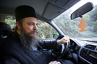 Mount Athos - The Holy Mountain.<br /> Father Theophilos drives his car to the capital Karyes.<br /> Photographer: Rick Findler