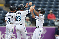 West Michigan Michigan Whitecaps outfielder Jacob Robson (7) is greeted at the plate by teammates Cam Gibson (23) and Danny Woodrow (8) against the Fort Wayne TinCaps during the Midwest League baseball game on April 26, 2017 at Fifth Third Ballpark in Comstock Park, Michigan. West Michigan defeated Fort Wayne 8-2. (Andrew Woolley/Four Seam Images via AP Images)