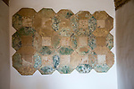 Tiled wall tiles display archaeological display inside the Alcazar palace, Cordoba, Spain