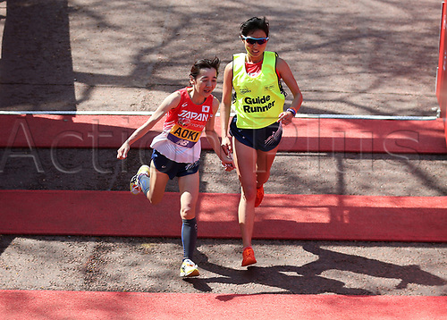 22nd April 2018, London, England; The 2018 Virgin London Marathon; Yoko Aoki of Japan with her Guide Runner crosses the finishing line in the T11/12 Women race