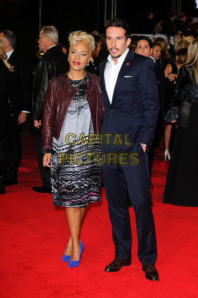 Emeli Sande and Adam Gouraguine .Royal World Premiere of 'Skyfall' held at the Royal Albert Hall, London, England..October 23rd, 2012.full length maroon leather jacket grey gray black print dress blue shoes suit white shirt married husband wife  .CAP/CJ.©Chris Joseph/Capital Pictures.