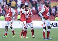 BOGOTÁ -COLOMBIA, 01-12-2013. Jugadores de Santa Fe muestran su tristeza al ser eliminado su equipo por el Itaguí en partido por la fecha 4 de los cuadrangulares finales de la Liga Postobón  II 2013 jugado en el estadio Nemesio Camacho el Campín de la ciudad de Bogotá./ Santa Fe players  show their sadness to be eliminated their team by Itagui in match for the 4th date of final quadrangulars of the Postobon  League II 2013 played at Nemesio Camacho El Campin stadium in Bogotá city. Photo: VizzorImage/ Gabriel Aponte /