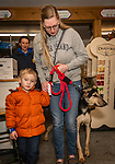 CHESHIRE, CT. 05 January 2020-010520BS73 - Anita Heffernan of West Haven, walks out of building holding onto her nephew Ryan Shore, 4, of East Haven and her newly adopted dog named Roger, at Cheshire Cats and Dogs Too on Sunday. Bill Shettle Republican-American
