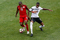 Commerce City, CO - Thursday June 08, 2017: Darlington Nagbe and Kevan George during their 2018 FIFA World Cup Qualifying Final Round match versus Trinidad & Tobago at Dick's Sporting Goods Park.