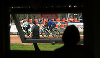 13 SEP 2014 - IPSWICH, GBR - A volunteer watches racing at the  2014 British Open Club Cycle Speedway Championships from the club hut at Whitton Sports & Community Centre in Ipswich, Great Britain  (PHOTO COPYRIGHT © 2014 NIGEL FARROW, ALL RIGHTS RESERVED)