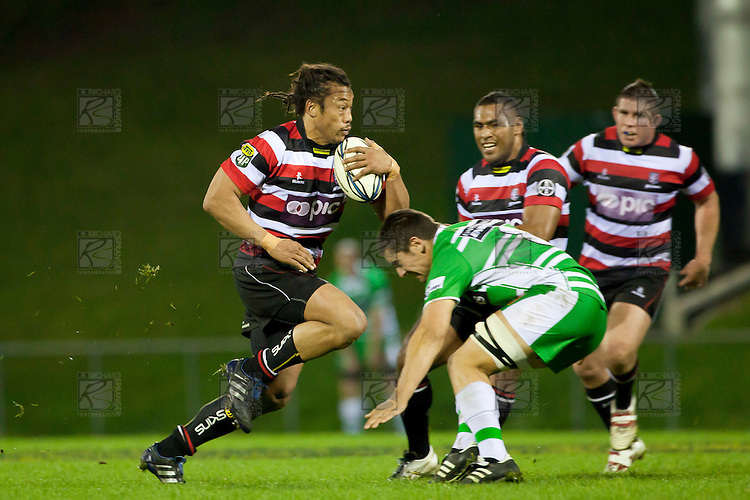 Tana Umaga charges into the tackle of Mitchell Crosswell. ITM Cup rugby game between Counties Manukau and Manawatu played at Bayer Growers Stadium on Saturday August 21st 2010..Counties Manukau won 35 - 14 after leading 14 - 7 at halftime.
