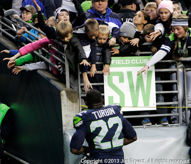 Seattle Seahawks  fans hold out their hands in hope running back Robert Turbin gives them his gloves after their game against Minnesota Vikings at CenturyLink Field in Seattle, Washington on  November 17, 2013.  The Seahawks beat the Vikings 41-20.  ©2013.  Jim Bryant. All Rights Reserved.