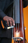hands of Nathan East on bass