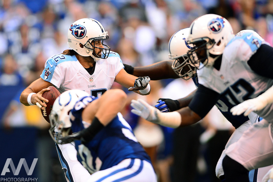 Sep 28, 2014; Indianapolis, IN, USA; Tennessee Titans quarterback Charlie Whitehurst (12) is sacked in the backfield during the second quarter against the Indianapolis Colts at Lucas Oil Stadium. Mandatory Credit: Andrew Weber-USA TODAY Sports