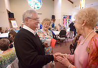 NWA Democrat-Gazette/BEN GOFF @NWABENGOFF<br /> Pastor Fred Nelson (from left) talks with church members Glenda Heist and Alice Rahlfs on Sunday May 29, 2016 during a retirement reception for Nelson at United Lutheran Church in Bella Vista. Nelson was the pastor of the church for over five years before stepping down in 2009 to serve as interim pastor for other congregations. Nelson served his last day in the pulpit at United Lutheran earlier in May after returning to serve as interim pastor for the congregation over the past 18 months.