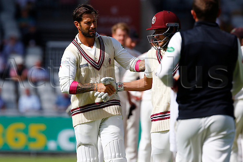 01.09.2016. Old Trafford, Manchester, England. Specsavers County Championship. Lancashire versus Somerset.  Peter Trego (left) congratulates Somerset wicket-keeper Ryan Davies after he was bowled by Tom Bailey for 86. He and Peter Trego had added 236 for the 8th Somerset wicket.