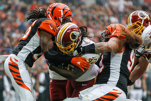 30.10.2016. Wembley Stadium, London, England. NFL International Series. Cincinnati Bengals versus Washington Redskins. Washington Redskins running back Silas Redd (32) is tackled by Cincinnati Bengals cornerback Josh Shaw (26) and defensive tackle Domata Peko (94).  Final score: Washington Redskins 27-27 Cincinnati Bengals after overtime.