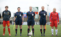20140208 - OOSTAKKER , BELGIUM : Belgian captain Aline Zeler (l) pictured with Belgian assistant referee Ella De Vries , Belgian referee Sharon Sluyts , Belgian assistant referee Staphanie Forde and Polish Captain Patrycja Pozerska (r) during a friendly soccer match between the women teams of Belgium and Poland , Saturday 8 February 2014 in Oostakker. PHOTO DAVID CATRY
